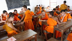maths lesson, the break (detengase) Tags: school boy orange colour feet boys colors canon eos asia asien southeastasia prayer religion culture monk buddhism unesco monks barefoot tradition laos luangprabang offerings alms moine louangphrabang novices northernlaos theravadabuddhism