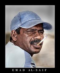 Smoker (Emad AL-Saif) Tags: portrait people searchthebest indian smoking kuwait smoker soe smok supershot shieldofexcellence excapture kuwaitartphoto
