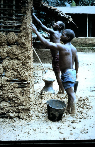 putting mud on the walls at Afarama