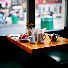 A Breakfast in SoHo (Inside_man) Tags: newyork green 120 6x6 mamiya tlr c220 film window colors fruit mediumformat milk strawberry colorful bokeh manhattan soho citylife blueberry teapot yogurt greentea granola woodtable portranc abreakfastinsoho