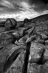 Arse rock (Ian Humes) Tags: blackandwhite bw rural canon landscape blackwhite cloudy boulders coastal canon350d limestone burren karst biancoenero blancinegre countyclare noireblanc artinbw landscapesshotinportraitformat