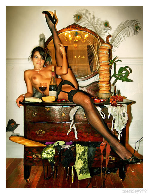 Natalie - Atop Her Antique Dresser Littered With Lingerie & a Variety of French Cheeses, Red Wine, Feathers & Grapes, Adjusts Her Leg to Avoid Toppling a Tower of 12 Cheese Burgers in a Brass Bowl as a Little Black Bird Lands on a Bottom Drawer Baguette