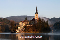 Lake Bled in Slovenia (Euroshots) Tags: autumn sunlight mist mountains church bells sunrise dawn europe european slovenia bled morningsun lakebled mistymorning sloveni bledisland euroshots pletnaboats mlino euroshot bledsloveniamist