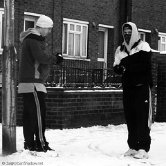 Restless Natives (Clockwork Noggin) Tags: uk bw snow men monochrome candid norfolk streetphotography nike hoody snowball masked adidas staring greatyarmouth lonsdale southquay blackwhitephotos canoneos400d clockworknoggin yarmouthflickrmeet