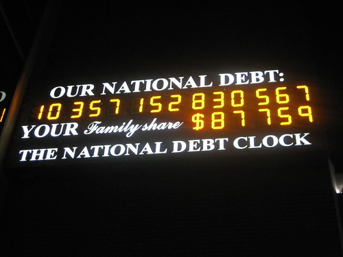 the national debt clock in times square at night