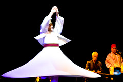 Whirling Dervishes (tochis) Tags: music white motion blur musicians moving dance movement spain muslim religion zaragoza arab twirl spinning syria ritual ecstasy es 1001nights trance dervish dervishes syrian whirl aragn expo2008 expozaragoza2008 alkindi