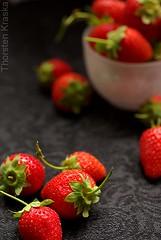 Black Fruit Series - Strawberries (Thorsten (TK)) Tags: red stilllife food black fruit still strawberry strawberries frucht fruity fraise fragola erdbeere erdbeeren frchte onblack fresa foodphotography foodpresentation fresn foodstyling lafresa thorstenkraska elfresn