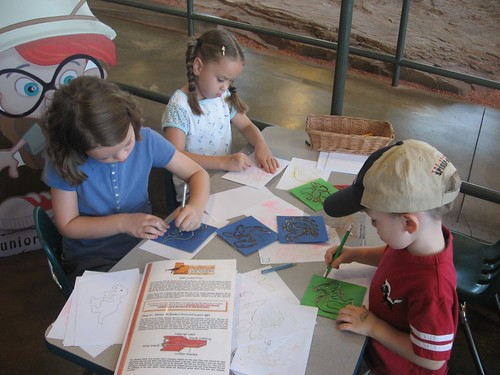 Tracing dinosaurs at the tracks museum.
