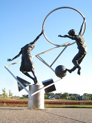 "Title: ""Primary Shapes""Sculptor: Jeff BarberAccessible to Public: yes, outdoorsLocation: Bridgewater Elementary SchoolOwnership: School District 659Medium: bronze, stainless steelDimension: 8 feet tallProvenance: commissioned by the schoolYear of Installation: 1998Physical Condition: good"