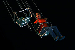 Solitary Ride (jonathan ponce) Tags: ambientlight cne midway popular canadiannationalexhibition theex tpmg canoneos30d canonef135mmf2lusm myflickr2 copyrightjonatha