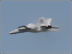 The speed of the Super Hornet (eraut) Tags: contrail airshow explore usnavy usn aerobatics clevelandoh transonic fighterjet fa18f blueribbonwinner canon30d supershot clevelandnationalairshow explored eos30d fa18superhornet jetcontrail anawesomeshot impressedbeauty sigma150500mmf563 shootingwithjason bigthankstoq