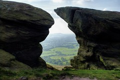 England, Peak District: Between a rock and a hard place. (Tim Blessed) Tags: uk sky nature clouds landscapes scenery rocks peakdistrict sunbeams moorland theroaches singlerawtonemapped