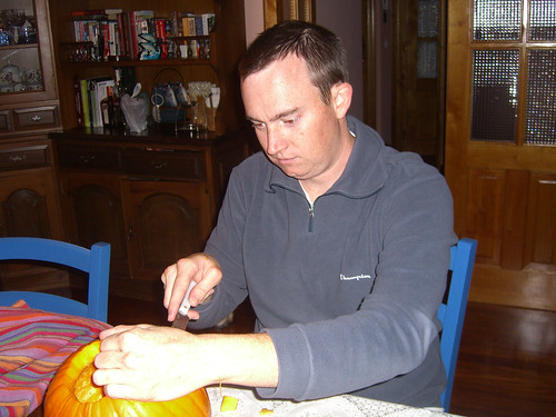 Erik carving pumpkin