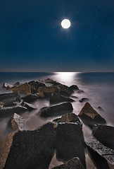 Vilano Beach Moon Rocks (JamesWatkins) Tags: ocean longexposure moon seascape art nature water photoshop stars landscape coast rocks poetry shorelines florida digitalart wideangle luna atlantic nighttime coastal moonrise sirius orion beaches wa nightsky poems thesea theocean staug atlanticocean moonscape beachart afterdark seas poets naturalart beautifulscenery stargazing vilanobeach d300 ps3 staugustineflorida sigma1020mm creativewriting starscape darkscape starrystarrynight oceanscape beachscenes 5photosaday flickrsbest theeastcoast oceanart jameswatkins poetryandpicturesinternational coastalscenes poemsandpictures oceanvista coastalart colourartaward thebeachatnight flickrlovers skyportraits moonportraits vilanobeachflorida thefloridacoast peregrino27newvision