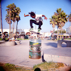 Over the Can (Brian Auer) Tags: california street people sunlight man color male film beach outside person fly jump lomography unitedstates kodak outdoor toycamera 120format streetphotography naturallight diana photowalk skateboard venicebeach skater trick leap soar skateboarder asa400 portra400vc 75mm stakeboarding october08 negativecolorfilm featuredonadidapcom photowalking102508 upcoming:event=1273880