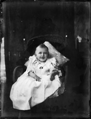 Small child wearing smocked dress (Powerhouse Museum Collection) Tags: portrait baby white smiling hands child dress brooch australia wicker cushion smock powerhousemuseum xmlns:dc=httppurlorgdcelements11 dc:identifier=httpwwwpowerhousemuseumcomcollectiondatabaseirn379093 httpwwwiraqwbascomvb