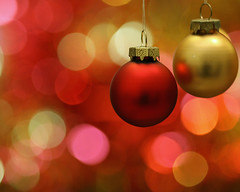 Christmas baubles, tinsel and lights (Mukumbura) Tags: santa christmas xmas decorations red party orange colour macro tree glass glitter gold lights navidad globe colours bokeh decoration balls noel celebration ornament ornaments tinsel yule santaclaus merry bauble baubles yuletide 10daystogo festiveseason decemberbokehfest gettyholidays2010