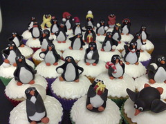 March of the Penguin cupcakes (SmallThingsIced) Tags: christmas party children penguins cupcakes hats presents scarves toppers embossed