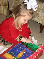 sarah opening a present