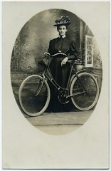 Josie and Her Bicycle (Alan Mays) Tags: christmas xmas old ohio portraits vintage women holidays photos antique hats bikes josie bicycles photographs taylor postcards oh salem 1908 1900s foundphotos backdrops bicyclists studiophotos elizabethtaylor december25 rppc phemera realphotopostcards