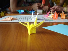 my first paper crane (Shaima82_4) Tags: color cute paper table hands ship crane working nippon 20 maru yallow swy swy20