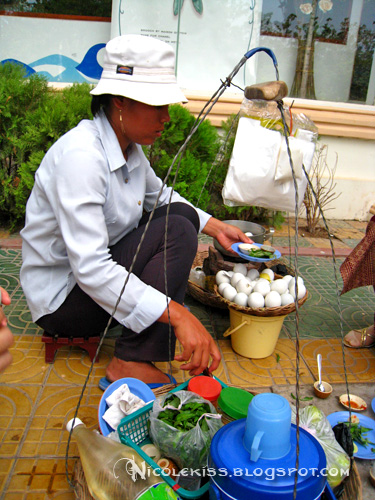 vendor selling duck fetus eggs