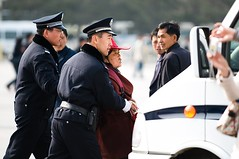 Arresting a Street Vendor (Eric Wolfe) Tags: china people beijing police criminal vendor guards tiananmensquare seller arrest chn original:filename=200803150060jpg
