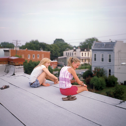 two girls on a roof
