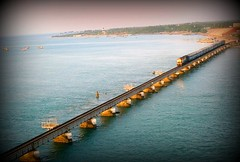 looks like a toy train to me...:-) (Arpana/Rajal) Tags: bridge sea india colors train effects picnik rameshwaram southindia sonydscw90