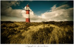 Southern Beach Lighthouse (Gert van Duinen) Tags: red sky brown lighthouse white seascape green beach nature yellow germany landscape island scenery dunes dune digitalart scenic insel nostalgia northsea nostalgic 2008 landschaft hdr landschap eiland borkum municipality lowersaxony explored dutchartist nikond80 anawesomeshot landschaftsaufnahme cresk tokinaatx124pro gertvanduinen northwesterngermany lesamisdupetitprince leerdistrict hoyapro
