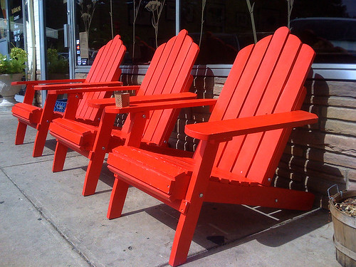 Red chairs outside the Suburban Trading Co in Kensington, Maryland - Taken With An iPhone