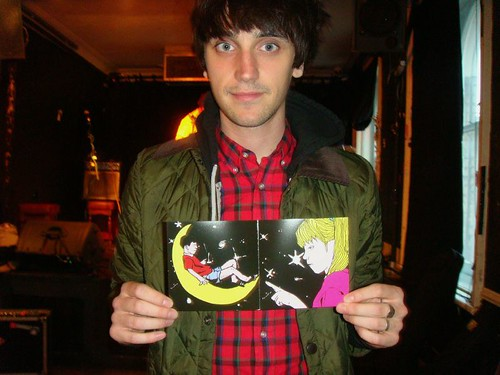 Dan from Televised Crimewave drew and has QOS compilation inside booklet