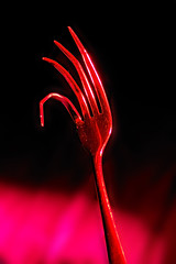 Attack of the Killer Fork (CliffMuller) Tags: lighting red halloween dark sinister creative fork spooky claw 50mmf18 augustenburroughs nikond40 pfogold wouldneverhaveguessedtheresagroupforforksonflickr