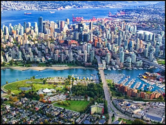 City that I love... (ecstaticist) Tags: city bridge blue urban green english water vancouver creek plane airplane bay harbor fly pacific flight aerial casio commute yaletown greenery burrard arrival coal float false jewel density oter exf1