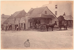 [Weatherboard buildings, Market Street, at the corner of Clarence Street, Sydney], [Dec 1875] / by unknown photographer