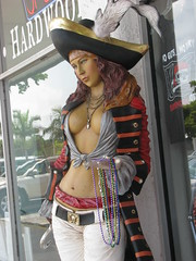 PIRATE WOMAN OF ANNA MARIA ISLAND (roberthuffstutter) Tags: hot beads buttons pirates hats piracy and navel mascots swf midriff poses showoff giftshop staredown appeal piratesbooty beltbuckles blouses skullandcrossbones showingoff prettylady decoys sexappeal annamariaisland lovebeads piratess norules whitejeans thegreeter waistline over400views whatashame yesorno heydude fashionpirate femalepirate worldzbestfotoz prettyyoungwoman florid