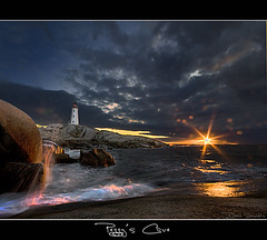 Black Hole Sun (Dave the Haligonian) Tags: ocean sunset sky sun lighthouse canada storm clouds nikon waves novascotia spray atlantic sunburst nautical d200 halifax peggyscove soundgarden sigma1020mm chriscornell blackholesun adobephotoshopcs4 nkn8784nef imageharvesting