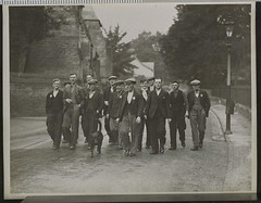 Jarrow Marchers en route to London (National Media Museum) Tags: poverty road trees england dog men lamp hat march streetlamp protest cobblestone jacket leash curb nationalmediamuseum jarrowmarch jarrowcrusade