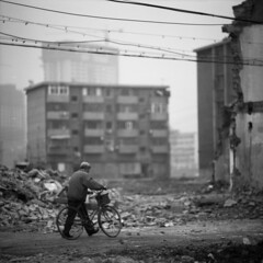 the end (memetic) Tags: china street bw man 6x6 bicycle buildings asian uncut blackwhite cyclist tmax chinese demolition 100  vanishing tianjin rubble 30x30  arax60 disappearing