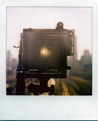 good morning el dorado (Js) Tags: morning toronto sunrise buildings landscape polaroid sx70 cntower traintracks eldorado 600 polarizer 2009 bathurststreet groundglass focusingscreen eastward sonaronestep graflexcrowngraphic roidweek2009