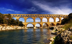 Pont Du Gard (Wolfgang Staudt) Tags: pont du gard remoulins gardon bridge roman empire aqueduct world heritage site unesco france city cityscape hrault big reflection sun afternoon late winter march maerz wolfgang staudt sigma wide angle travel photographie    holidays  europe fransa frankreich    fontaine water sky blue  windows  architecture grossstadt 66111 south nimes nikon d300 aquduktbrcke hdr reflexions the perfect photographer