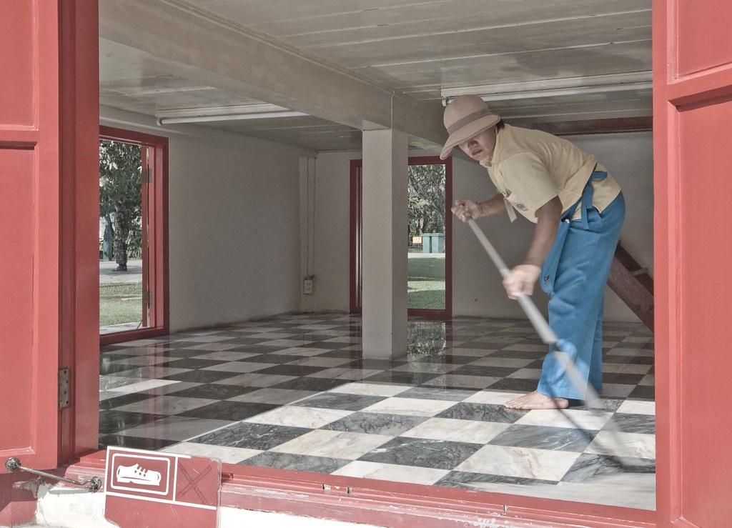 Cleaner polishing marble floor - Summer Royal Palace at Bang Pa In Thailand