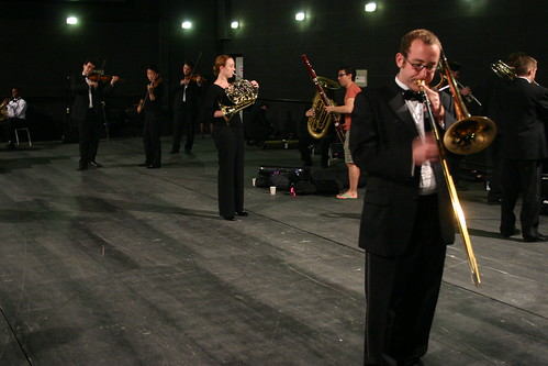 With no time to rehearase, orchestra members made the most of the time they had back stage to warm up