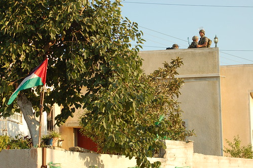 At Yousef's funeral, the Israeli Army takes over a family's roof