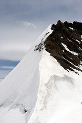 From the Mnchsjoch Htte 11,998 feet (Jim_Higham) Tags: christmas cloud mountain snow alps switzerland htte monk ridge alpine eiger jungfraujoch bernese jungfrau hutte mnch oberland mnchsjoch mnchjoch travelerphotos