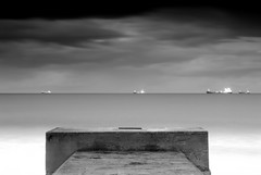 Ships in the night (~Glen B~) Tags: sea sky bw white black night clouds dark concrete dusk ships structure minimal passing redcar
