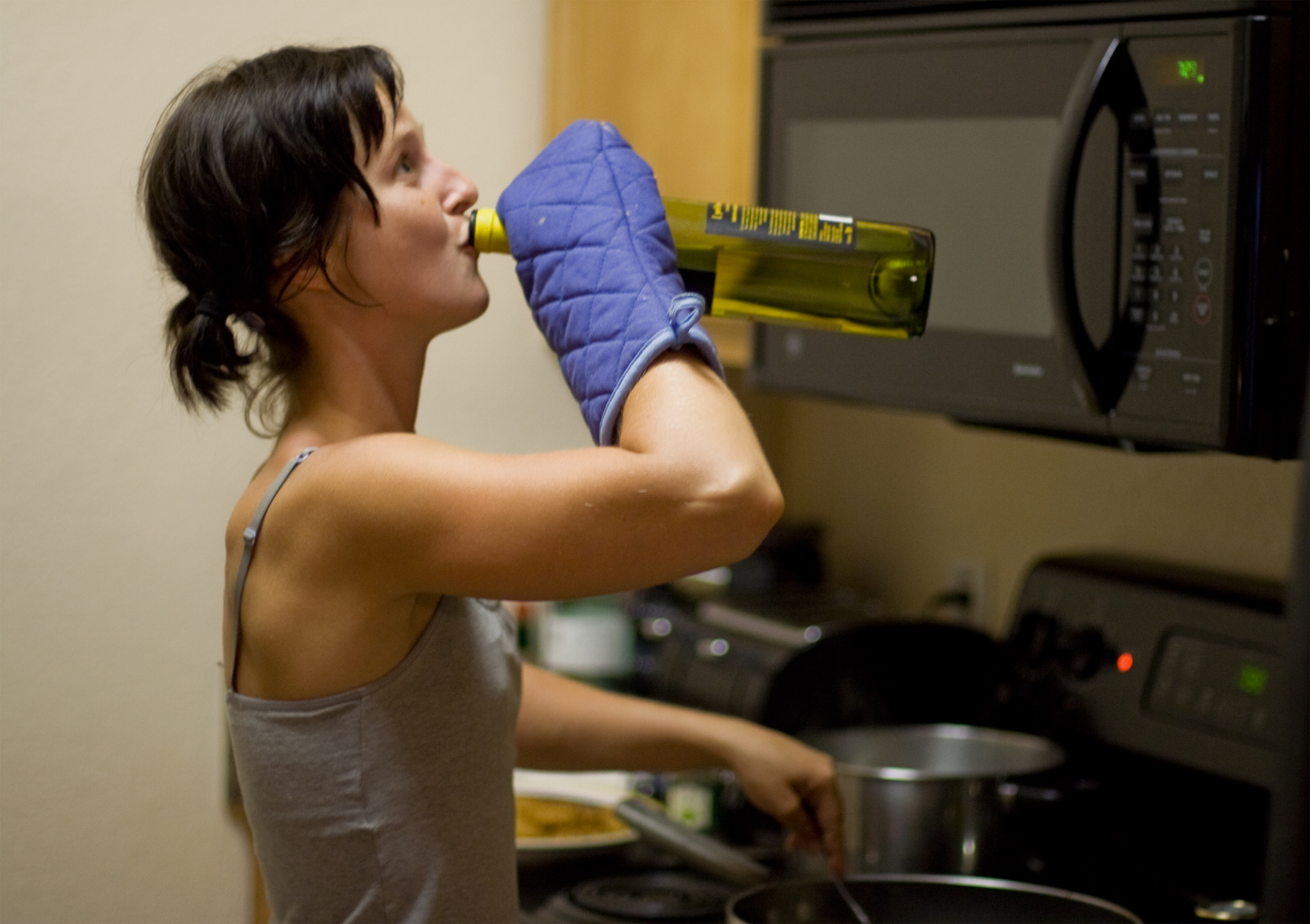 Image result for woman in the kitchen cooking and drinking