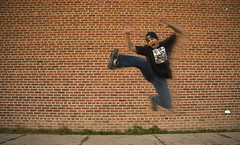 360/365 (menno-indian) Tags: selfportrait motion blur brick hat jump jumping tshirt toque motionblur brickwall jackson5 lotsoftags 365days 10secondtimer complimentsof rebelshootsfan becausemycheaporemotehasbecomequiteunreliable 2moocards