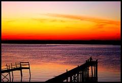 a fisherman's sunset. (lexiburpsalot) Tags: sunset red sky orange fish reflection water beautiful fisherman dock purple