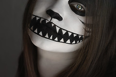 The Cheshire Cat (Lou Bert) Tags: portrait white black art halloween girl smile face make up cat self costume eyes paint cheshire teeth grin